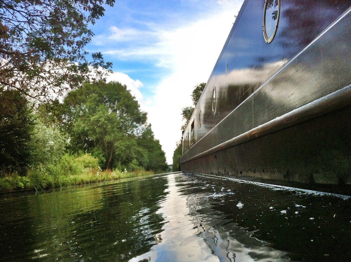 A narrow boat cruising down the grand union, canal