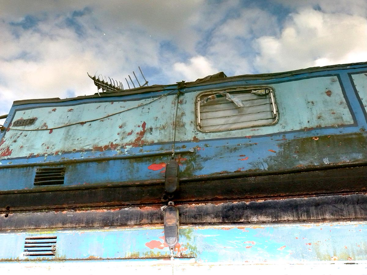 Rusty boat against a blue sky