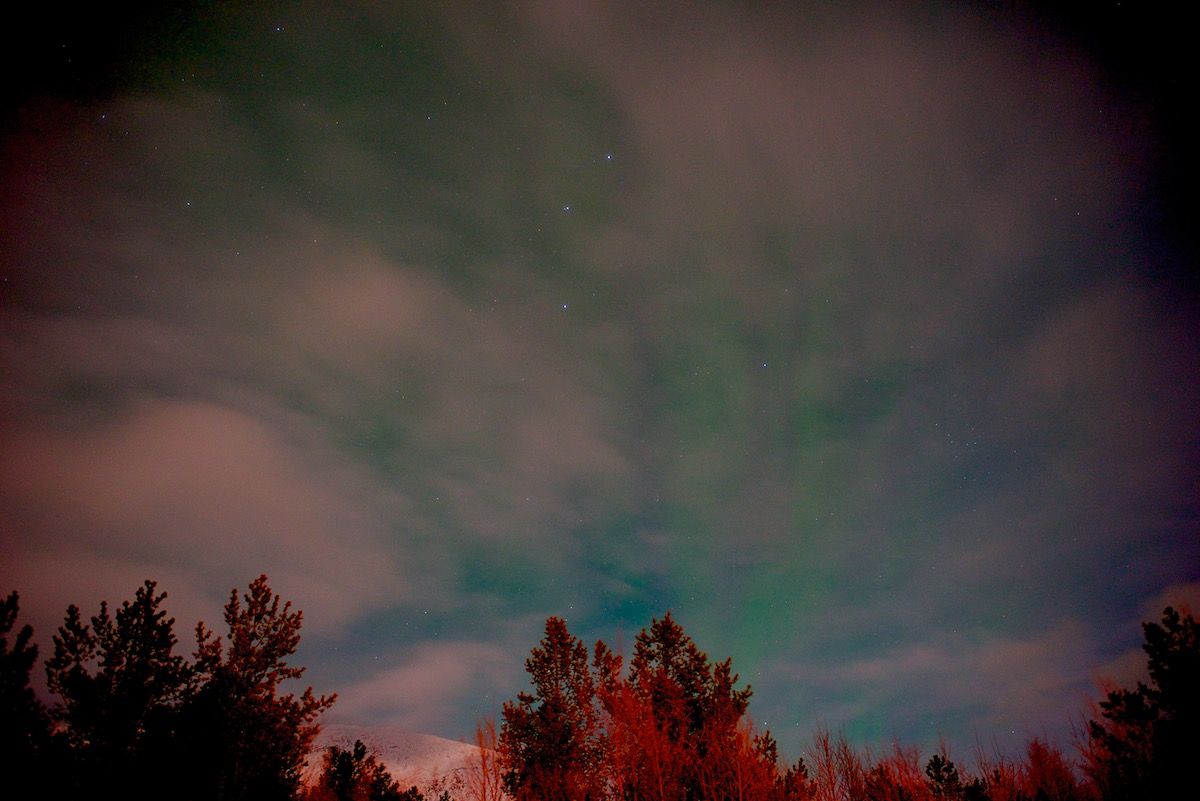 The Aurora Borealis shows faintly in the sky. Not even visible with the naked eye.