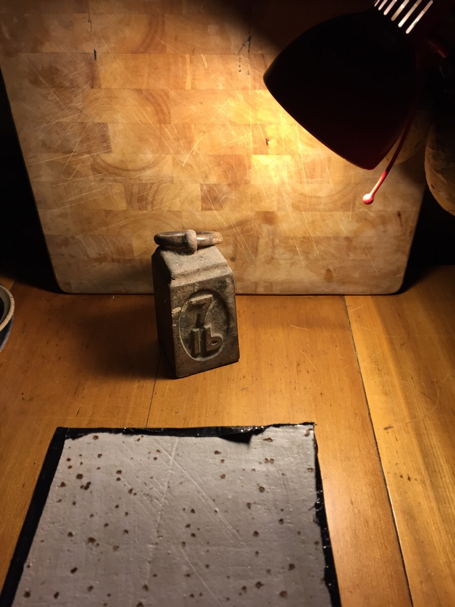 An angle poise lamp lighting a Ceramic Pinhole Camera exposure.