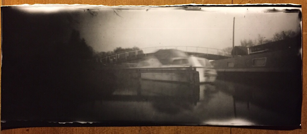 Foamcore Pinhole Camera image of a river cruiser.