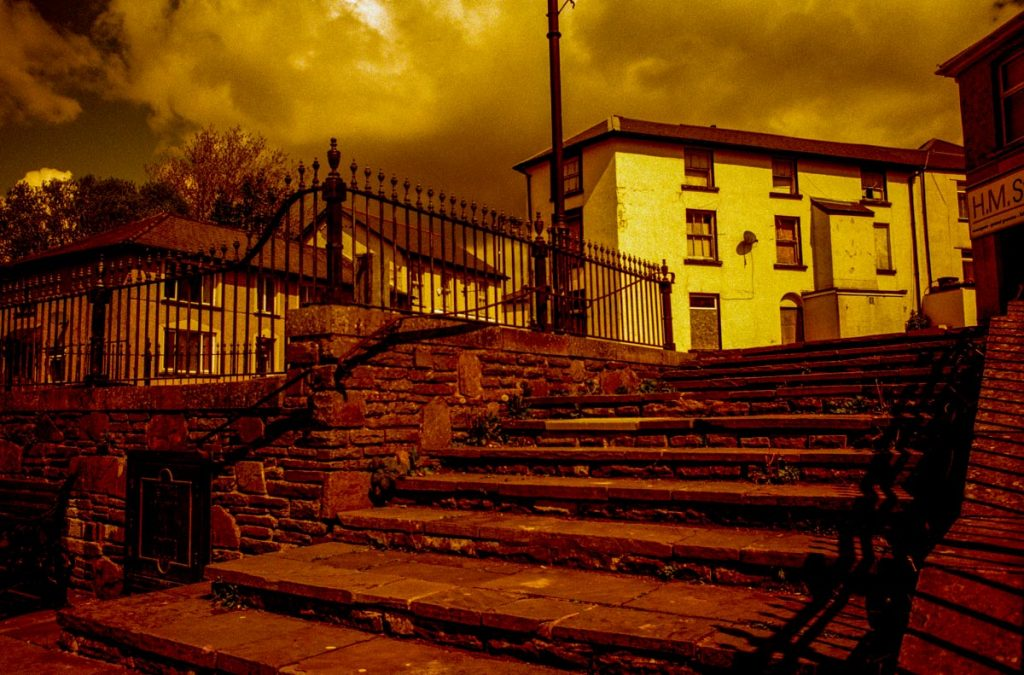 Redscale image of steps.